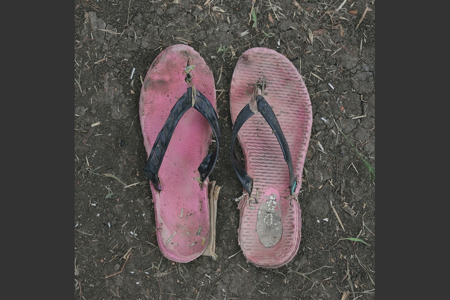 A pair of worn rubber sandals.